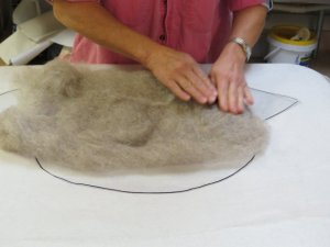Shaping felt to pattern.