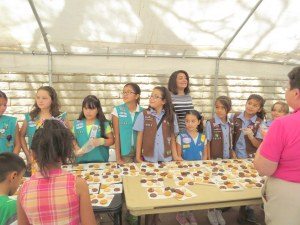 Girl Scouts serve cookies to clients and their families.