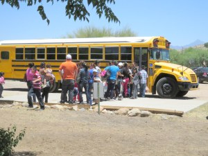 One of the free shuttles, in this case, a Nogales school bus.