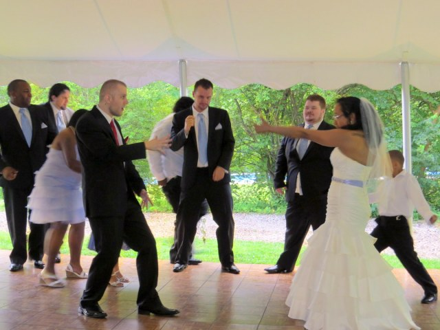 The wedding party dances first.