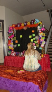 Woman adding a message to her departed loved ones.