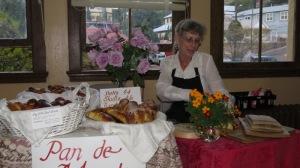 Kelly selling Día de los Muertos items.