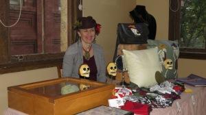 Vicky sells Día de los Muertos items.